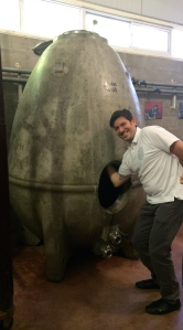 Carlos Gloger of Curitiba, Brasil, tests the inside of the 10-foot concrete egg used for a moderate and controlled fermentation at Zuccardi.