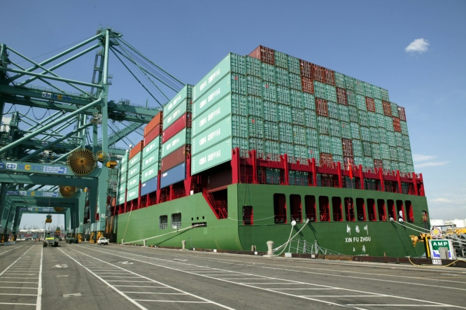 Your wine is here. Someplace. The announcement of a tentative settlement to the nine-month strike affecting 29 West Coast ports may means a return to normal commerce soon. Photo courtesy Port of Los Angeles